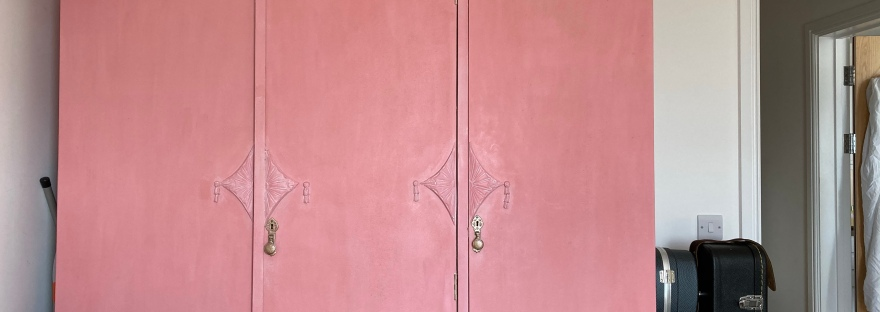 Large pink triple wardrobe with plants on the roof